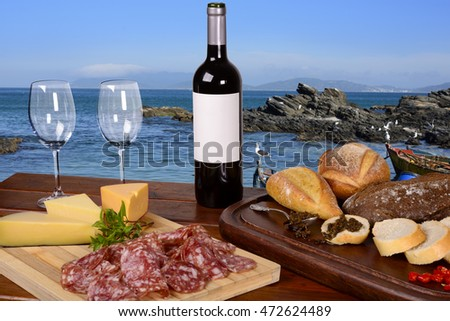 Charcuterie and Cheese Platter, Bread, Chimichurri and Red Wine by the Sea