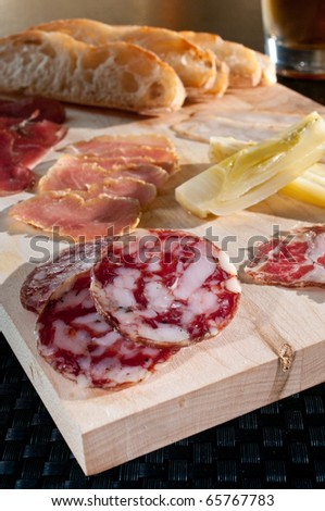 Charcuterie plate with fresh cured meats - stock photo