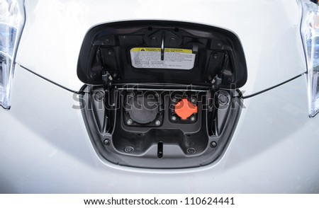 charge point on electric car - stock photo