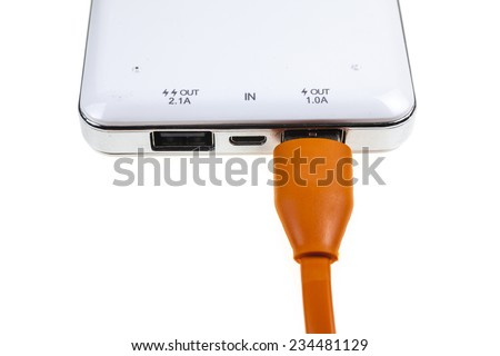 Charging a mobile phone with a powerbank - stock photo