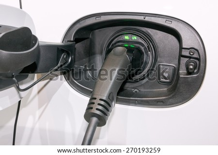 Charging an electric car. - stock photo