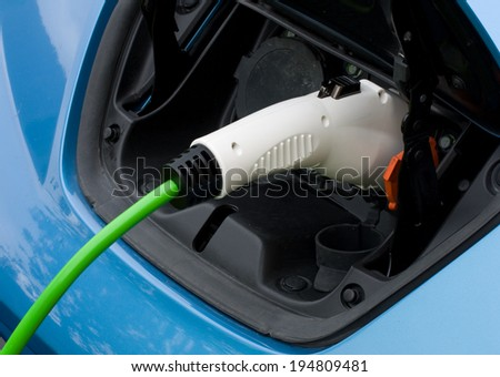 Charging an electric car using type 1 plug - stock photo