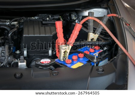 Charging battery car with electricity trough jumper cables