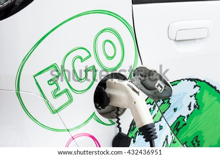 Charging electric car - stock photo