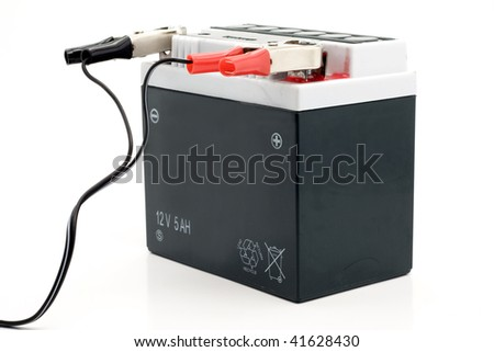 Charging motorcycle battery isolated on white background - stock photo