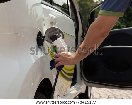 Charging of an electric car - stock photo
