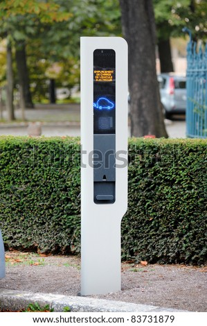 Charging point for electric vehicle in a public place. - stock photo