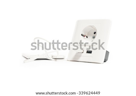 Charging. Smartphone charged from the socket, with two usb-charger ports. - stock photo