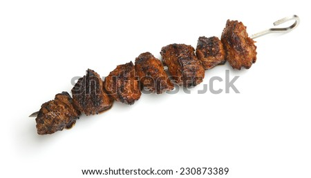 Chargrilled marinated lamb kebabs on white background.