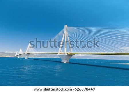 Charilaos Trikoupis Bridge. It crosses the Gulf of Corinth near Patras, linking the town of Rio on the Peloponnese peninsula to Antirrio on mainland Greece by road, longest of suspended type bridges.