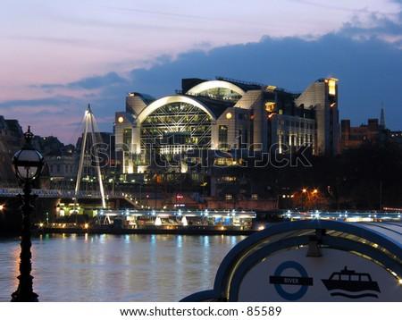 Charing Cross Station & Millenium Bridge across river thames twilight. - stock photo
