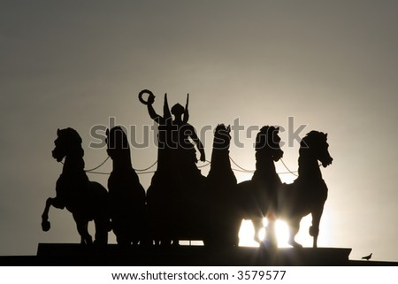 Chariot of Glory on the Triumphal Arch in Moscow. Early in the morning. Bird at right lower corner. - stock photo