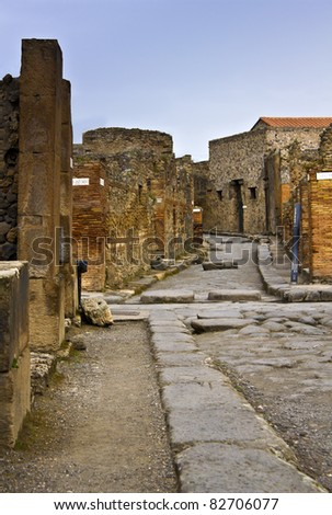 Chariot road in Pompeii, Italy.The ruined Roman city it was completely buried in ash when the volcano Mount Vesuvius erupted - stock photo