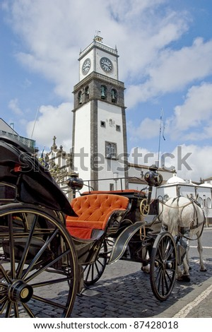 Chariot waiting for tourists at Sao Miguel main clock tower, Azores island at Portugal - stock photo
