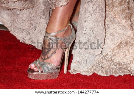 Charisma carpenters tattoo on her foot stock photo safe to use charisma carpenters tattoo on her foot is seen at the 4th annual thirst gala voltagebd Image collections