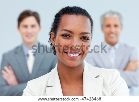 Charismatic afro-american businesswoman standing in front of her team - stock photo