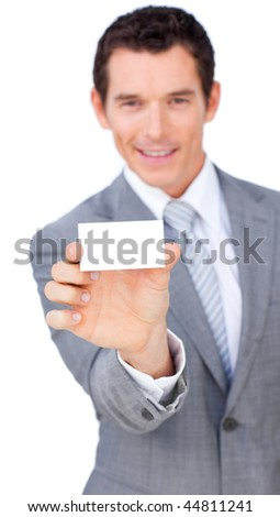 Charismatic businessman showing a white card against a white background - stock photo
