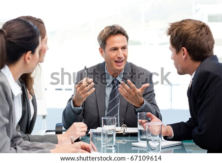 Charismatic chairman talking with his team during a meeting - stock photo
