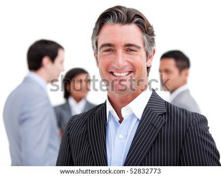 Charismatic mature businessman standing with his team against a white background - stock photo