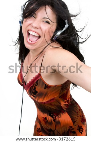 Charismatic woman dancing and enjoying upbeat music - stock photo