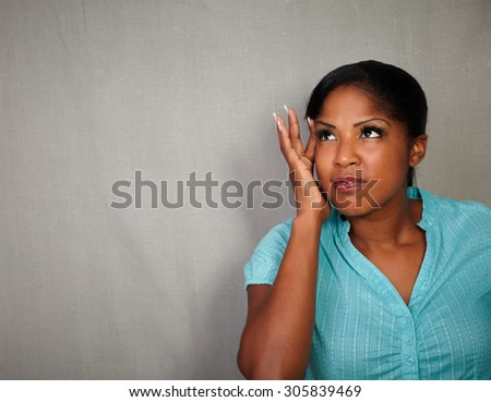Charismatic young woman of african ethnicity having a headache - copy space - stock photo