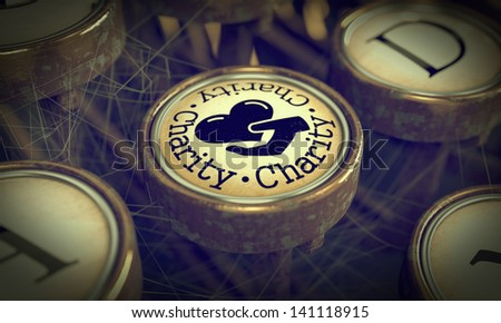 Charity Button on Old Typewriter. Grunge Background for Your Publications. - stock photo