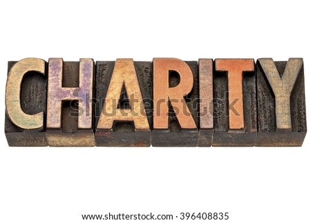 charity - isolated word in vintage letterpress wood type stained by color inks - stock photo