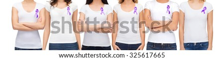 charity, people, health care and social issue concept - close up of woman with purple domestic violence awareness ribbon on her chest