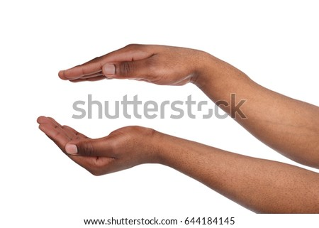 Charity, protection and care concept. Black male hands keep empty cupped palms together isolated on studio white background