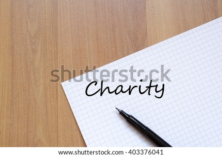 Charity text concept write on notebook - stock photo