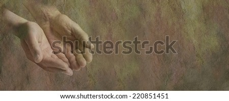 Charity website banner   -   Rustic effect male hands cupped in begging position on a stone effect background - stock photo