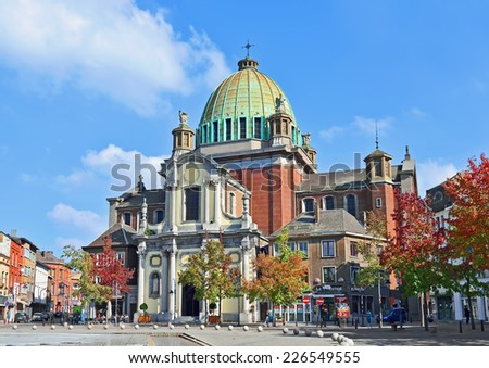 CHARLEROI, BELGIUM-OCTOBER 03, 2014: Center of Charleroi and Saint-Christophe church. The city and its region are the ones from mostly affected by the last crisis parts of the country - stock photo