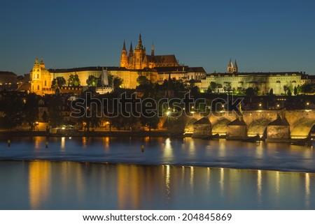 Charles Bridge and Prague Castle at dusk (Prague, Czech Republic) - stock photo