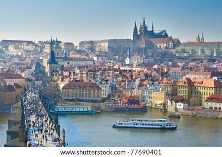 Charles Bridge and Prague Castle, view from the Bridge tower, Czech Republic - stock photo