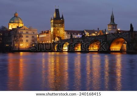 Charles Bridge and Prague Tower lighting at night - stock photo