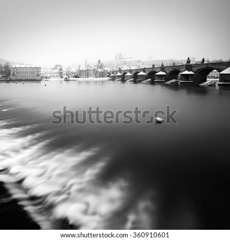 Charles bridge and St. Vitus cathedral during winter time, Prague, Czech republic - stock photo