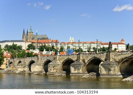Charles bridge and St Vitus cathedral on a bright, sunny day in Prague