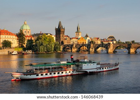 Charles bridge and travel boat, Prague, Czech Republic - stock photo