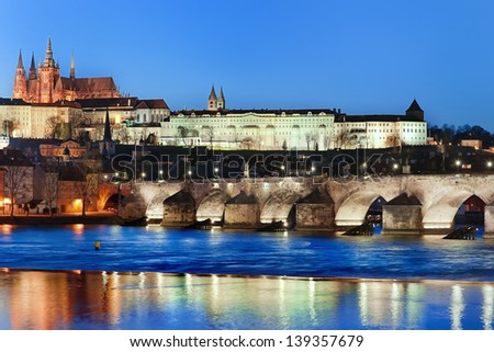 Charles Bridge and Vltava river by night, in the background the castle, Prague