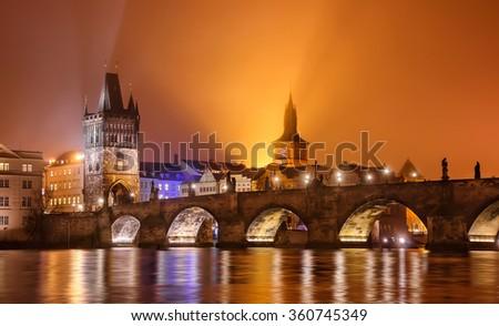 Charles bridge during foggy winter, Prague, Czech republic - stock photo