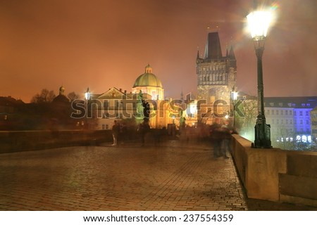 Charles bridge illuminated by night, Prague, Czech Republic - stock photo