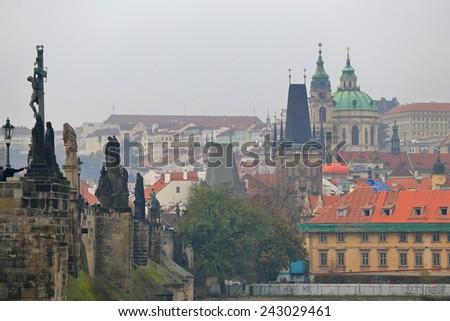 Charles bridge in cloudy autumn day, Prague, Czech Republic - stock photo