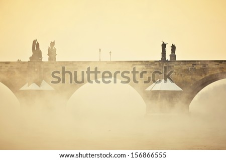 Charles bridge in morning fog, Prague, Czech Republic - stock photo