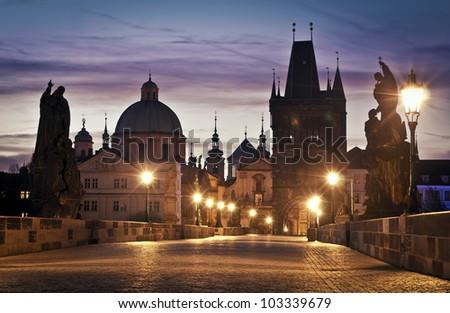 Charles Bridge in Prague at dawn; Czech Republic - stock photo
