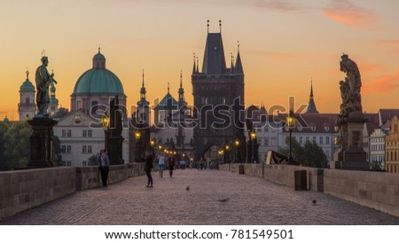 Charles Bridge in Prague before the sunrise Bohemia, Czech Republic. Orange sky