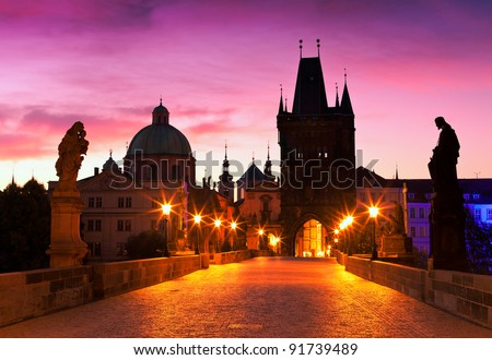 Charles Bridge in Prague (Czech Republic) at dawn - stock photo