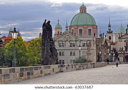 Charles Bridge in Prague during the sunrise Czech Republic. - stock photo
