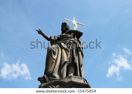 Charles Bridge, Prague, Czechia, Europe. Sculpture of St. John the Baptist on the foreground was created by Joseph Max in 1857. - stock photo