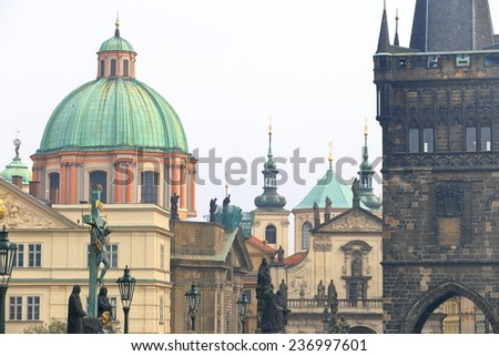 Charles bridge statues and distant towers and churches, Prague, Czech Republic - stock photo