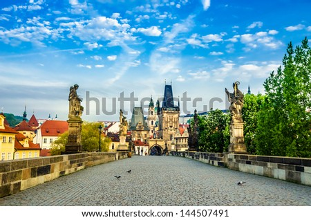 Charles bridge with its statuette, Lesser Town Bridge Tower and the tower of the Judith Bridge (which was Prague?s first stone bridge built in the first half of the 12th century (The Mala Strana). - stock photo